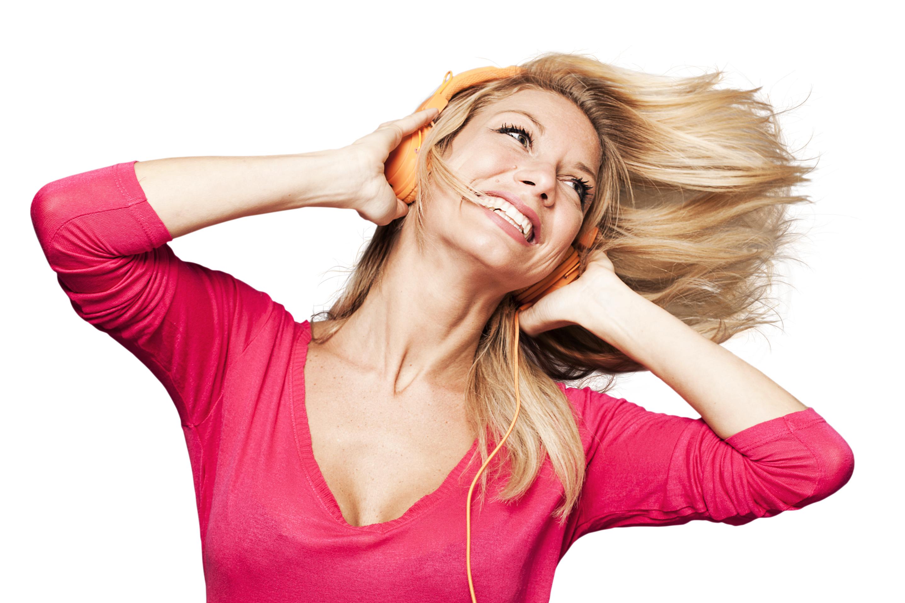 laughing blonde girl enjoying fun music with earphone on